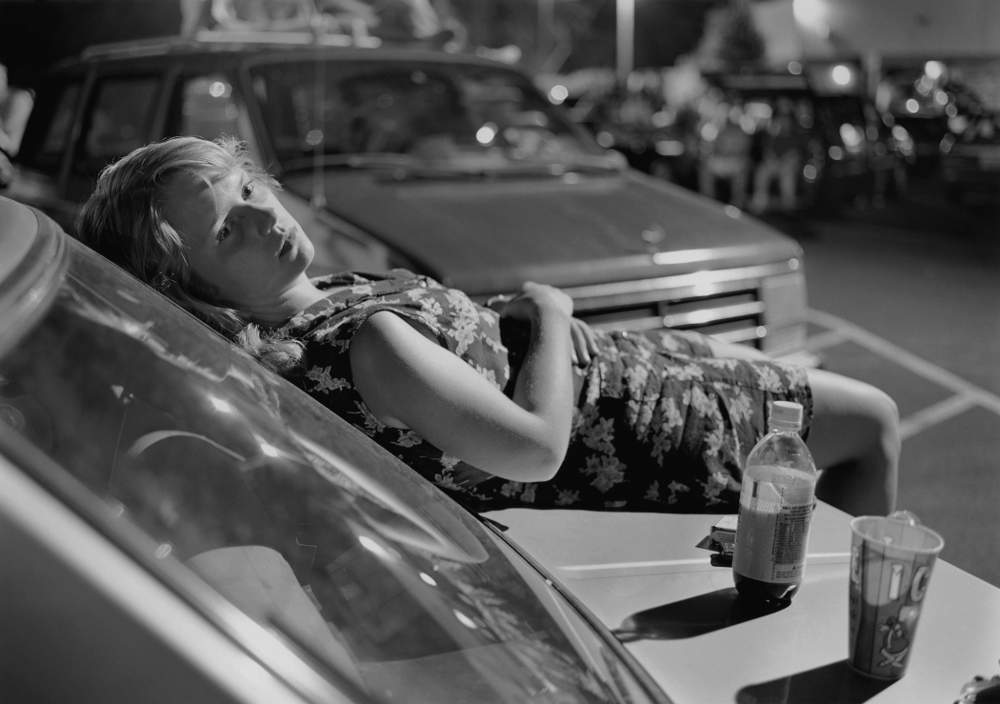 Mark Steinmetz, Athens, GA (girl on hood of car), 1996. Gelatin silver print. © Mark Steinmetz, Courtesy of the Artist and Yancey Richardson Gallery