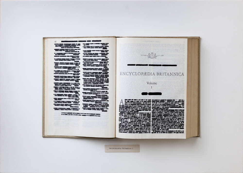 Emilio Isgrò, Encyclopaedia Britannica, Vol.1, 1969. India ink on typographic book in wood and plexiglas box, cm 50 x 75. Courtesy Archivio Emilio Isgrò