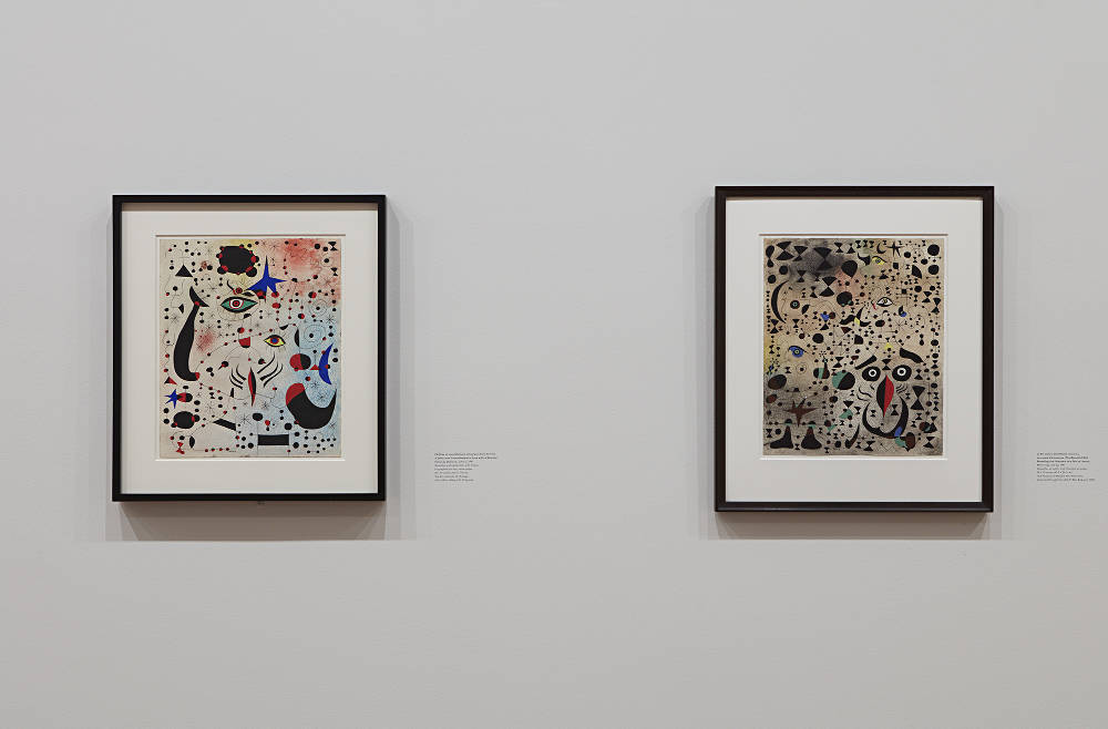 L-R: Joan Miró, Ciphers and Constellations in Love with a Woman. Palma de Mallorca, June 12, 1941. Lent by The Art Institute of Chicago; Gift of Mrs. Gilbert W. Chapman (1953.338) / Joan Miró, The Beautiful Bird Revealing the Unknown to a Pair of Lovers. Mont-roig, July 23, 1941. Lent by The Museum of Modern Art, New York; Acquired through the Lillie P. Bliss Bequest (7.1945). Photo by Kent Pell / Art © 2017 Successió Miró / Artists Rights Society (ARS), New York / ADAGP, Paris
