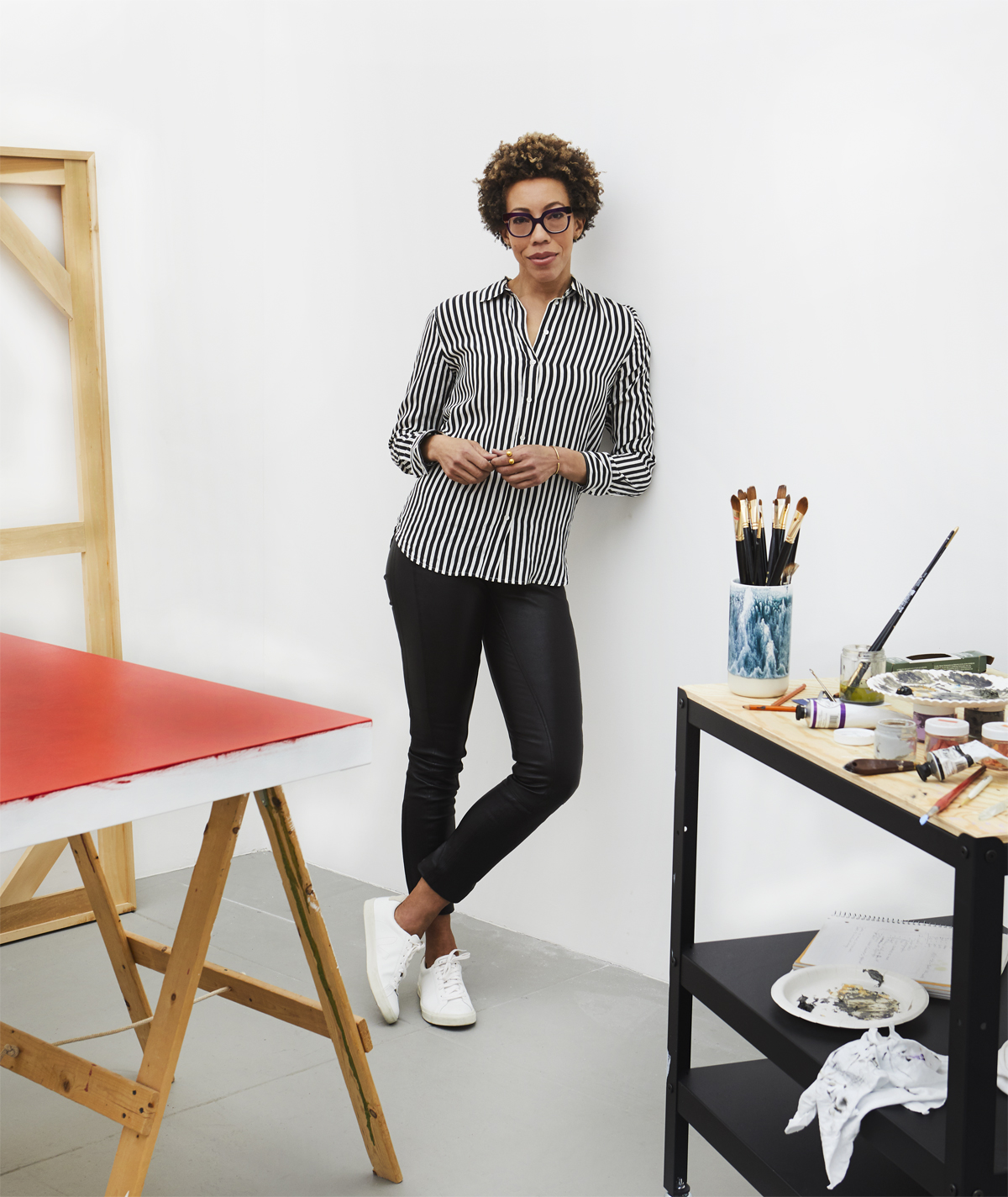 portrait of Amy Sherald in her studio