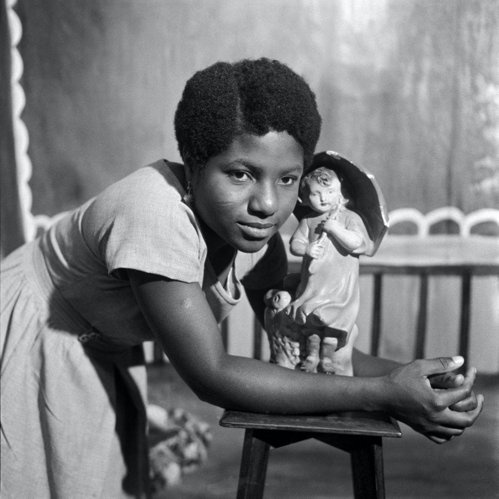 Beatrice with trademark figurine, Ever Young Studio, Accra