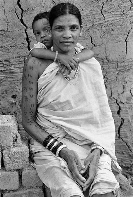 Woman with child. Village Alor, Bastar, India