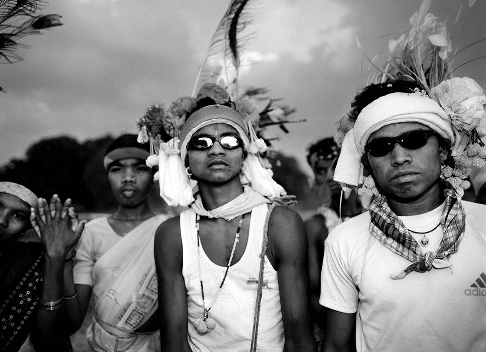 Dance troupe waiting to perform in Madai festival. Bade Donger, Bastar, India