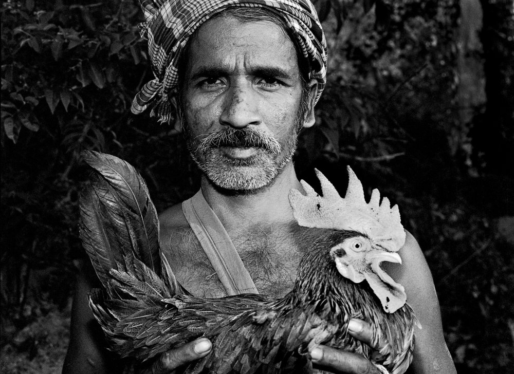 Man with prized possession. Village Bade Donger, Bastar, India