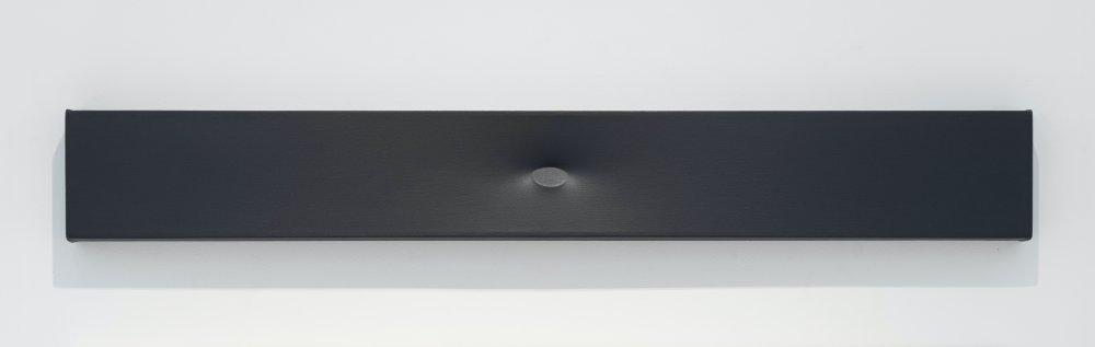 Superficie grigia con un ovale